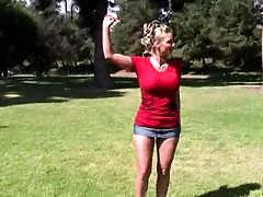 Phoenix Marie is out for some kite fun in the park