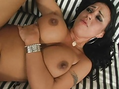 Agent Gunn unloads his load on these massive tits