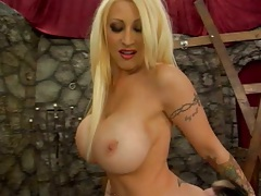 Posing blonde Candy Manson sits on mans face and spreads ass