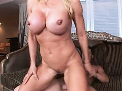 Hot babe Amber and her huge tits fucked on the couch