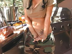 Hot busty army chef rubs spoon in her pussy