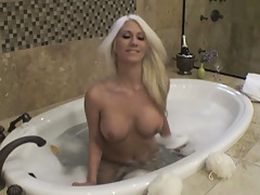 Chick walking around the shower naked for camera