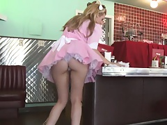 Lexi is a waitress in pink cleaning her diner