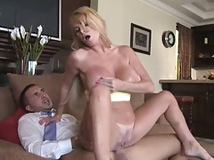 Huge tits Taylor Wayne sucking off a guy in a suit