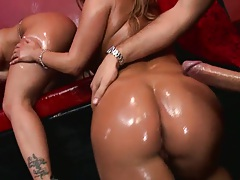 Two sexy babes fully covered in oil including anal fuck