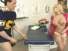 Big tits doctor spreads legs and plays with clit