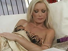 Hot blonde milf lays in bed all alone and pleasures herself
