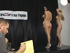 Hot round asses get oiled on stage