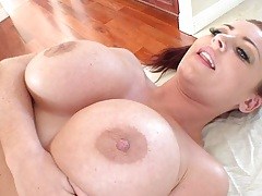Sophie Dee holds her big tits while massage fuck