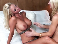Molly is making out with her naked friend also with big tits