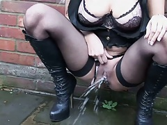 Pissing while squatting outdoors and showing ass in fishnet Poppy Morgan and Victoria Brown