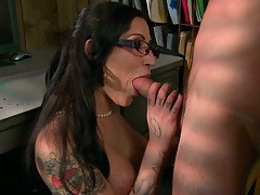 Daisy goes down behind office table and titty fucks