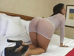Big round ass in fishnets over naked body Mia Bangg going for suck