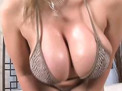 Big tits Sara Jay oils up her boobies