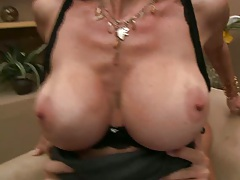 Milf Angel sitting on cock with huge tits