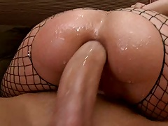 Lotion ass in fishnets anal penetration while sitting