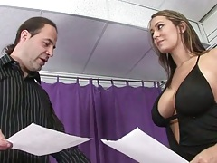 Babe with no bra Trina Michaels holds a penis shaft and slowly strokes it in cfnm