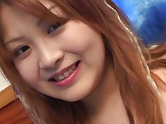 Asian girl sucks a vibrator