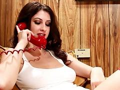 Brunette Karina White masturbating while on the phone