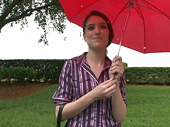 Zarena Summers standing under the rain picked up for bangbus ride