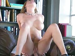 Big tits Krissy Lynn sits on her employers cock