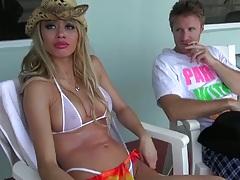 Sexy milf in a bikini and a cowboy hand