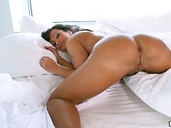Big ass milf Lisa Ann laying on her stomach receiving ass play