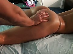 Hot tanned body gets lotion rubbed all over it
