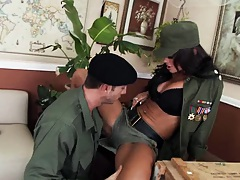 A big tits female dictactor spreads her legs