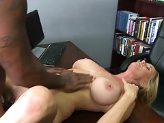 Milf leans back on the office desk